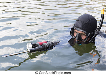 Underwater hunter dives into the sea