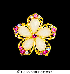 Brooch - Picture of isolated brooch with black background.