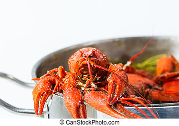 Boiled crayfish in pan on a wooden board, a traditional...