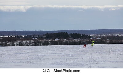 Winter snowkiting on the field. - People ride on winter...