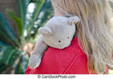 Teddy - Little blond girl hugging her teddy