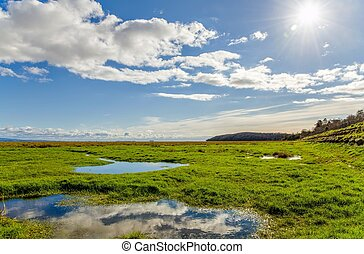 Clouds over fields, Grange-over-sands, Cumbria, England -...