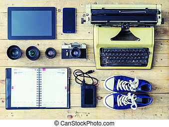 Typewriter, tablet, phone, camera, agenda, hdd storage and...