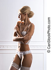 Young woman in bridal lingerie - Sensual and beautiful young...