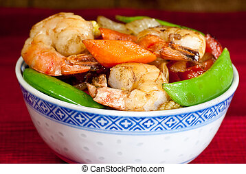 Mange tout and prawns - A bowl of prawns and vegetables stir...