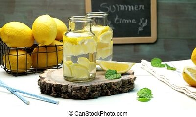 Lemon and lime slices in water jars