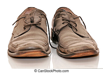Dirty Old Shoes - A pair of dirty old shoes isolated on...