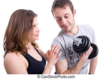 Fitness training - Young fitness instructor with her trainee...