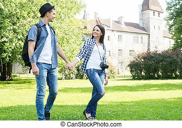 Couple having an enjoyable walk in the garden