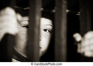 Imprisoned child behind bars - Single abused male child...