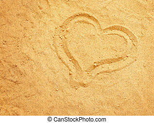 Valentine background. Heart on the sand