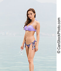 Asian woman in bikini