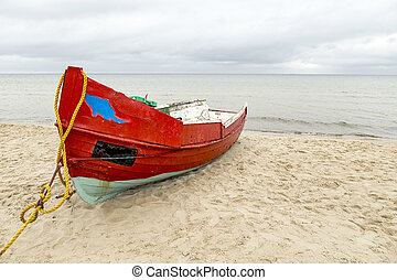 old wooden fishermens ship at the beach in Usedom