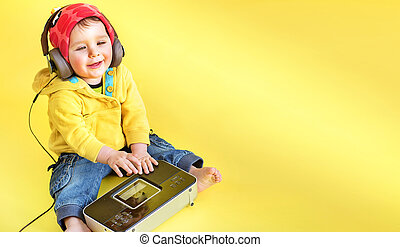 Satisfied little boy listening to music - Satisfied cute,...