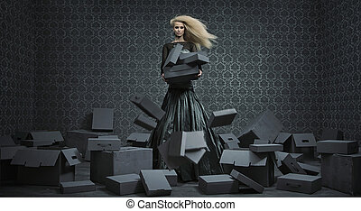 Conceptual picture of a blond lady among a lot of boxes -...