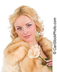 pretty model wearing fur coat with rose