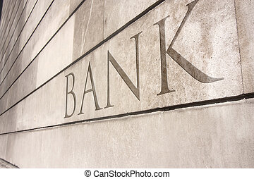 bank writing carved onto a stone wall - 3d visual of the...