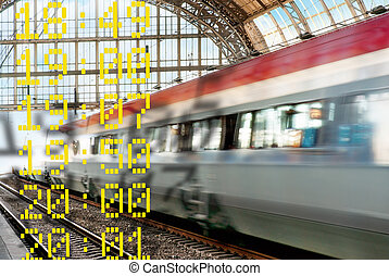 Train in blurred motion leaving a station, with departure...