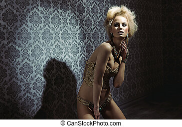 Sensual blond lady posing in a mysterious room - Sensual...