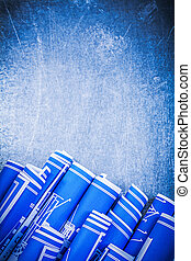 Set of blue rolled construction drawings on metallic...