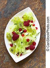 Berry Cucumber and Lettuce Salad - Fresh salad of raspberry,...