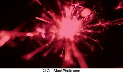 Close-up shot of red color sparkler Holiday or celebration...