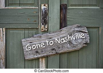 Gone to Nashville. - Gone to Nashville sign on old green...
