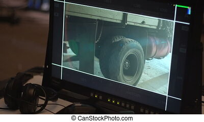 The wheel of the truck, hitting him on camera - Camera...