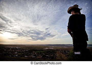 Panoramic View - A man looking over a panoramic view of an...