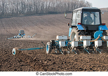 Tractor with sower on the field