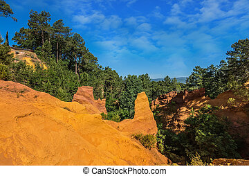 Green trees create a beautiful contrast with the ocher -...