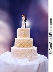 White wedding cake on table