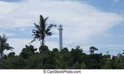 lighthouse and tropical palms.Malapascua Island