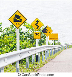 Road signs - Signs on curves and slopes road beside the sea
