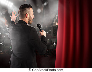 Showman - Man talking on microphone on theater stage