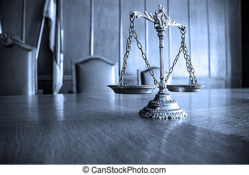 Decorative Scales of Justice on the table. Focus on the...
