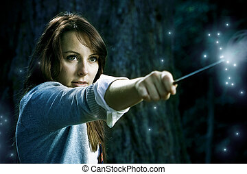 Wizard girl - Teenage wizard girl with magic wand casting...