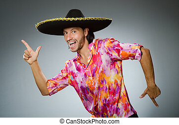 Young mexican man wearing sombrero