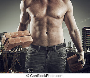 Sexy bricklayer - Sexy dirty bricklayer with brick in hand