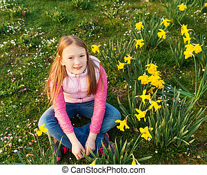 Spring portrait of a cute little girl of 8-9 years old,...