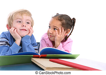 Kids laying down and reading books - a young boy and girl...