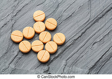 Medicines on black color stone - Close up medicine tablets...