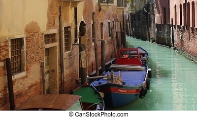 Colorful boat small canal Venice - Colorful boat in a small...