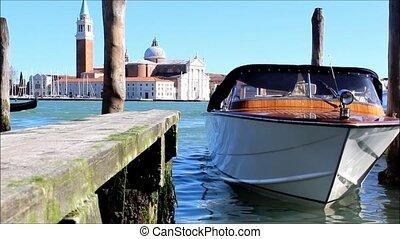 Small boat bobbing in Venice lagoon - Small tourist boat...
