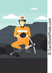 Miner holding coal in hands - An asian man sitting with coal...