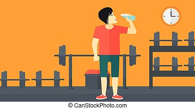 Man drinking water. - An asian man drinking water in the gym...