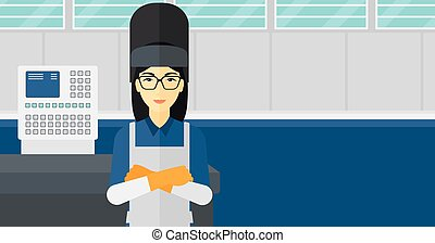 Confident smiling welder - An asian woman at factory...