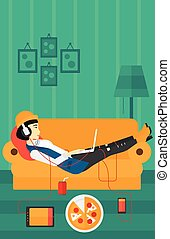 Woman lying on sofa with many gadgets.