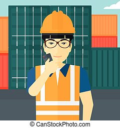 Stevedore standing on cargo containers background. - An...