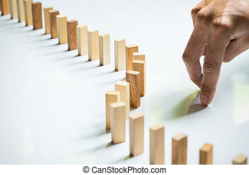 Finger like a business man and wooden block like reached an...